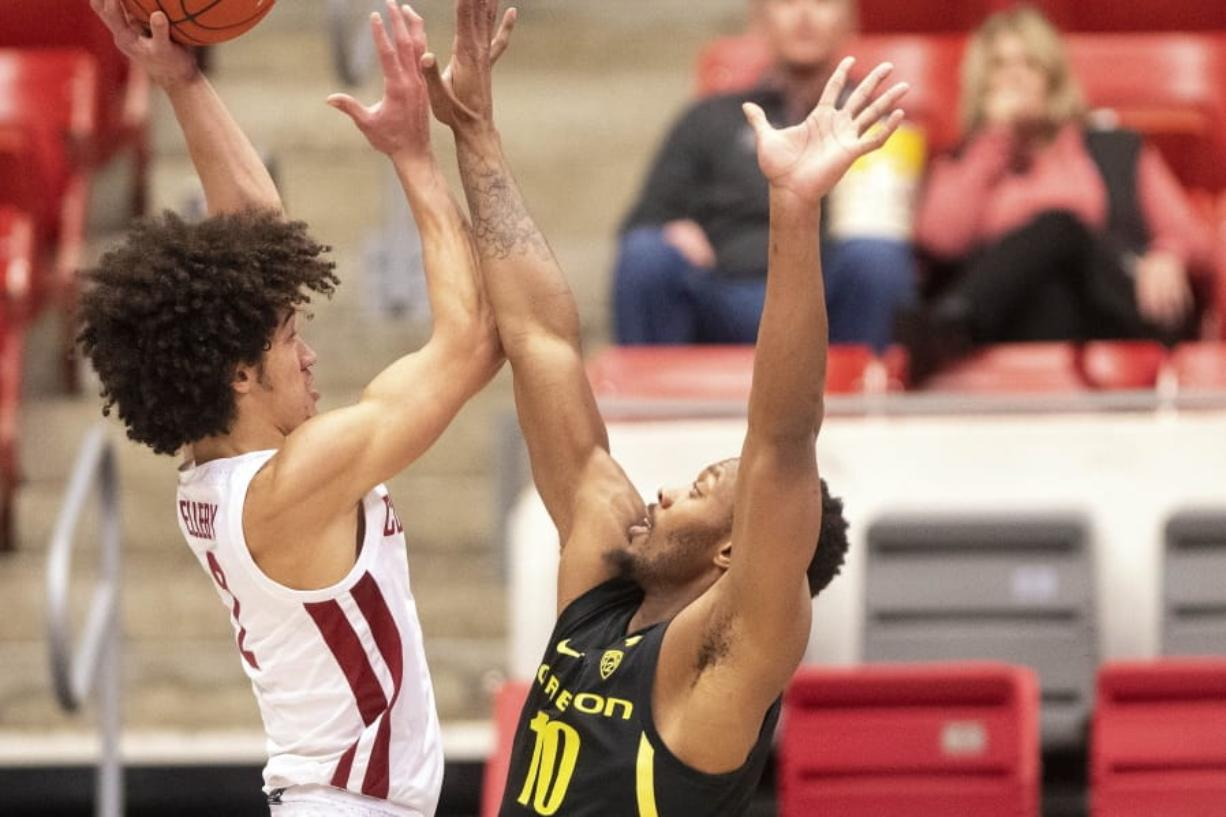 Washington State forward CJ Elleby (2) attempts a shot as Oregon forward Shakur Juiston (10) defends during the first half of an NCAA college basketball game Thursday, Jan. 16, 2020, in Pullman, Wash.