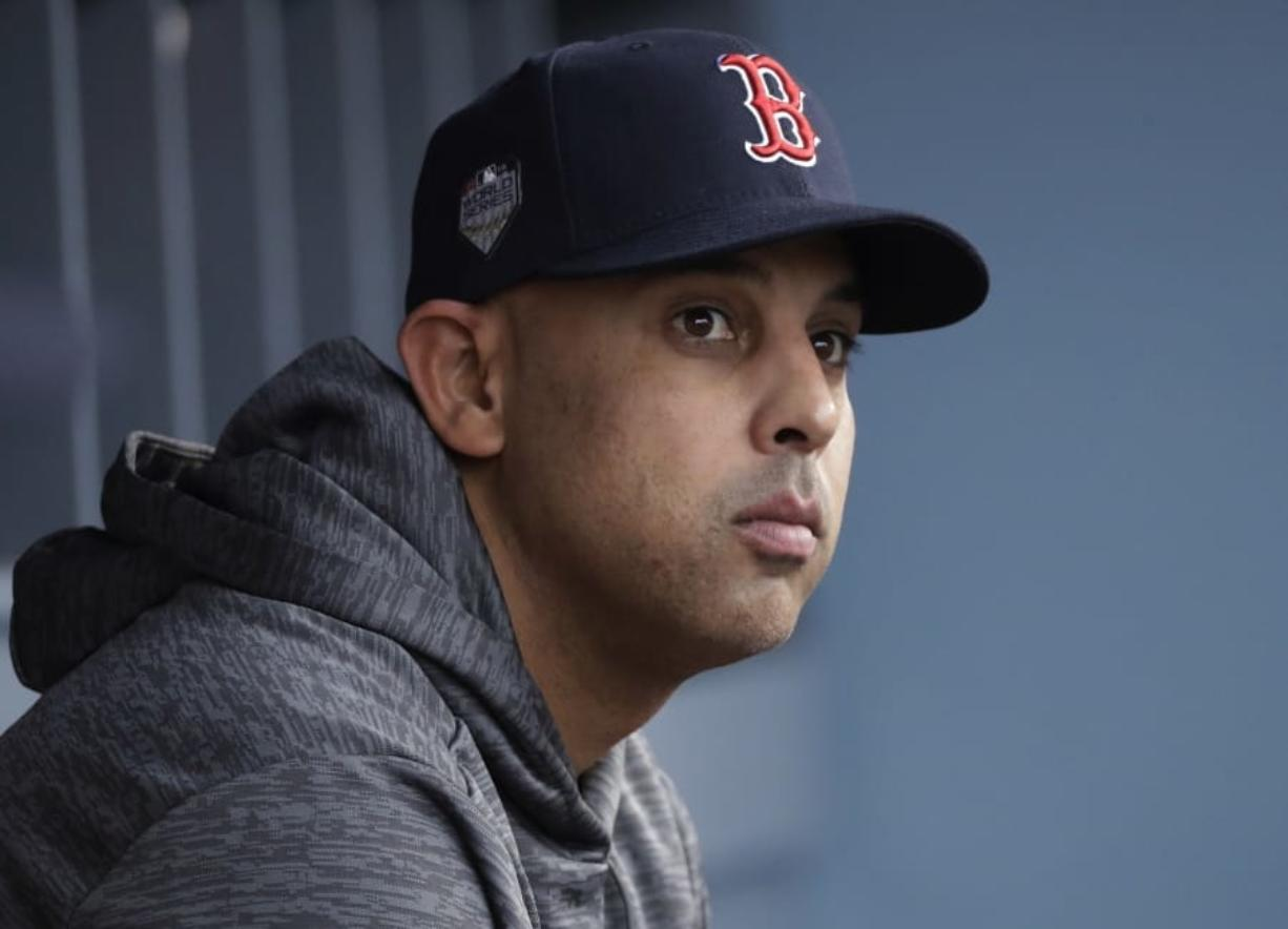 Boston Red Sox manager Alex Cora, who was fired on Tuesday, was named 11 times in the commissioner's report. (Associated Press)