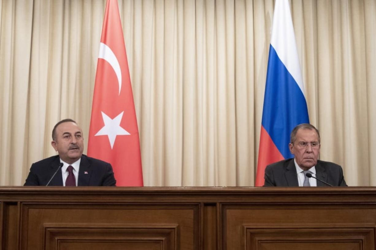 Turkish Foreign Minister Mevlut Cavusoglu, left, and Russian Foreign Minister Sergey Lavrov attend a joint news conference following their talks in Moscow, Russia, Monday, Jan. 13, 2020. Foreign and defense ministers of Russia and Turkey met as part of an effort by Moscow and Ankara to sponsor Monday's talks between rival parties in Libya in the Russian capital.