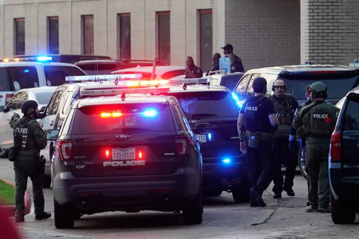 Police officers respond to a shooting at Bellaire High School, Tuesday, Jan. 14, 2020, in Bellaire, Texas.