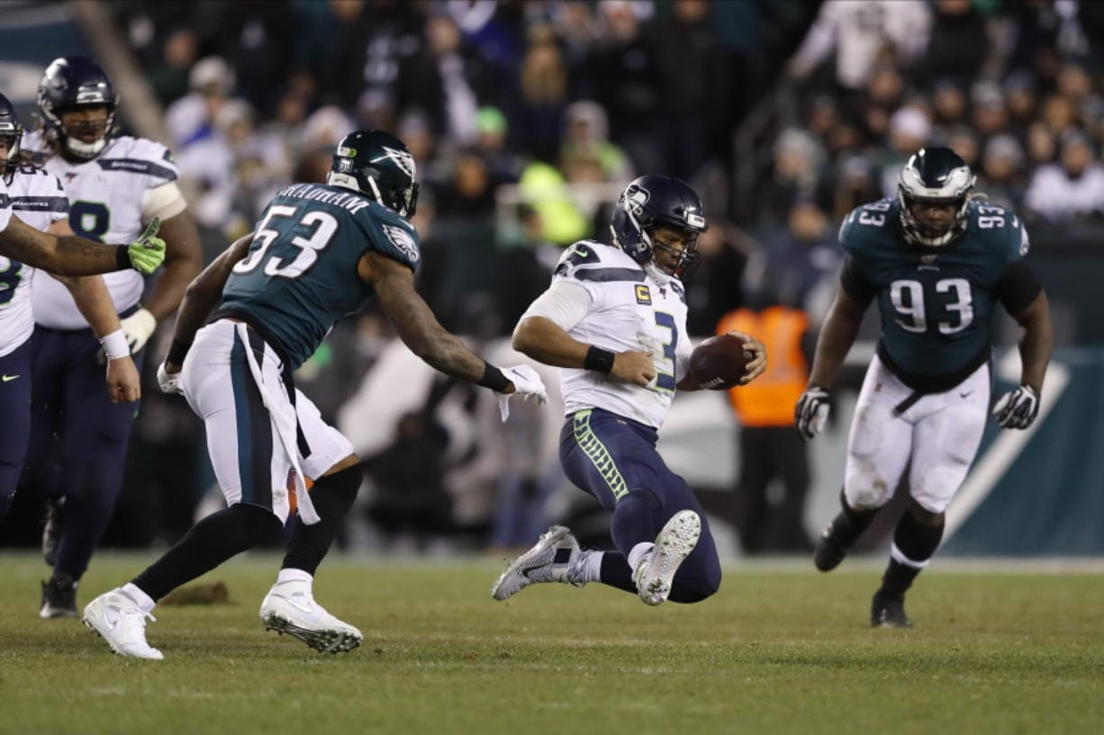 Seattle Seahawks' Russell Wilson slides during the second half of an NFL wild-card playoff football game against the Philadelphia Eagles, Sunday, Jan. 5, 2020, in Philadelphia. (AP Photo/Julio Cortez)