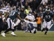 Seattle Seahawks' Russell Wilson slides during the second half of an NFL wild-card playoff football game against the Philadelphia Eagles, Sunday, Jan. 5, 2020, in Philadelphia.