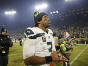 Seattle Seahawks' Russell Wilson walks off the field after a 28-23 loss to the Green Bay Packers in the NFL divisional playoffs on Sunday.