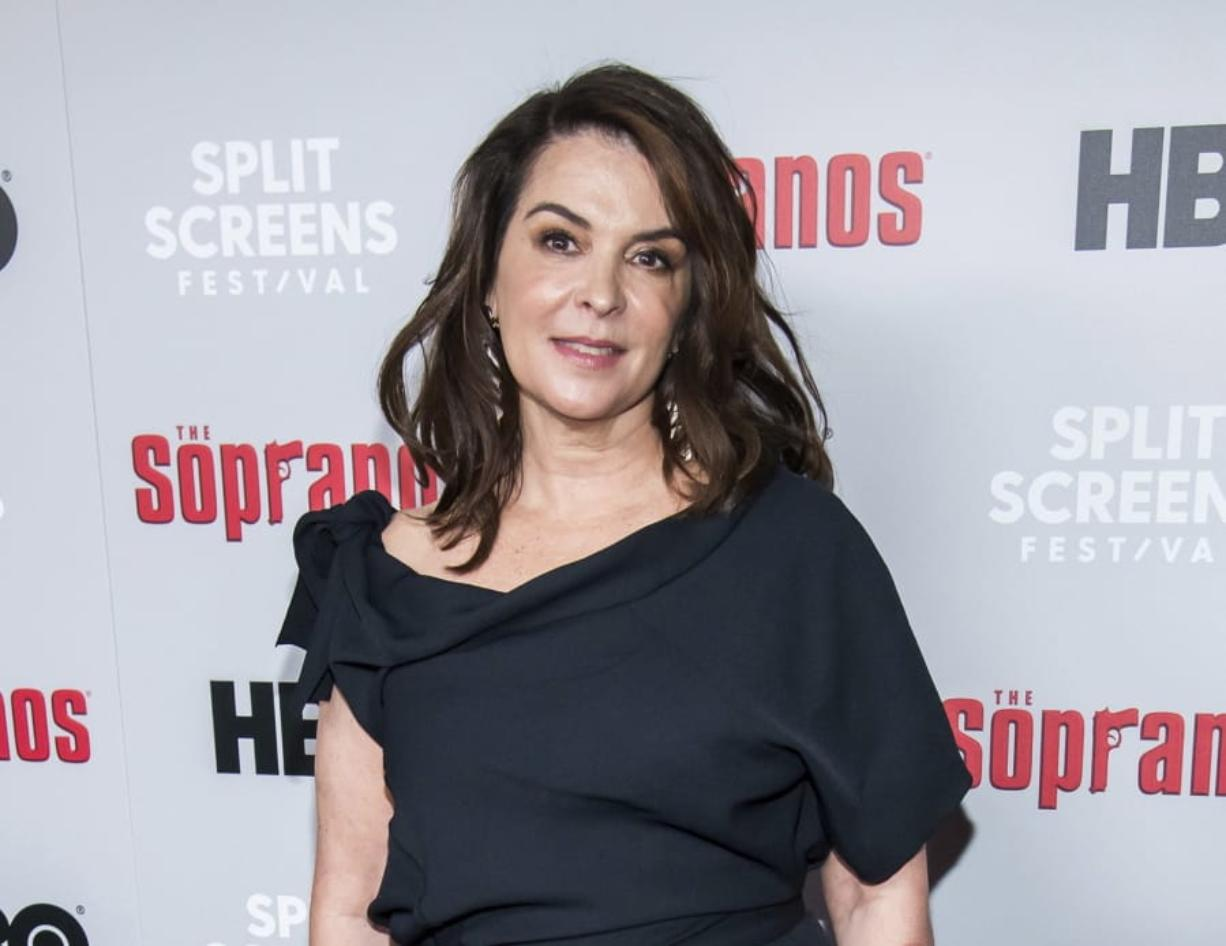 """FILE - In this Jan. 9, 2019, file photo, Annabella Sciorra attends HBO's """"The Sopranos"""" 20th anniversary at the SVA Theatre in New York. Sciorra is set to confront Harvey Weinstein at his New York City rape trial, more than a quarter-century after she says he pinned her to a bed and raped her. She is expected to testify Thursday, Jan. 23, 2020."""