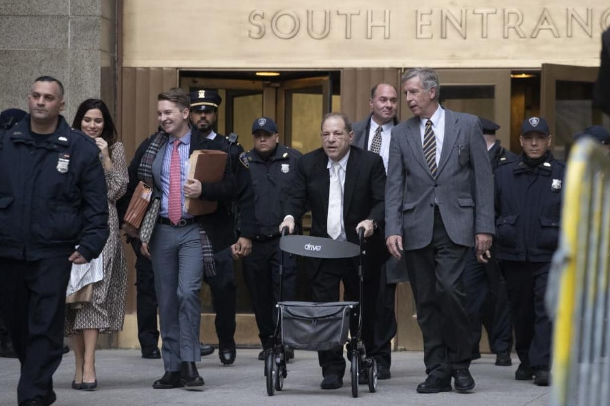 Harvey Weinstein uses a walker as he leaves a Manhattan courthouse after a day in his trial on rape and sexual assault charges, Thursday, Jan. 23, 2020, in New York.