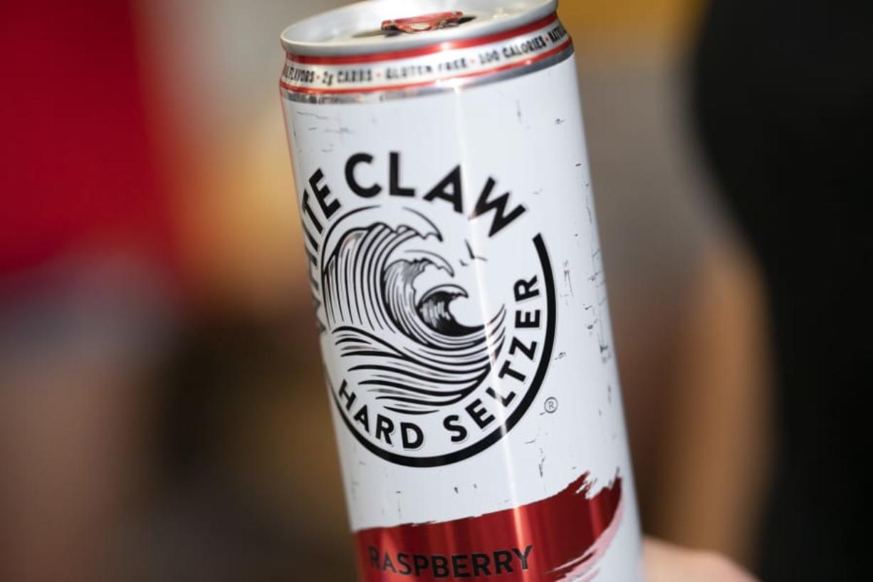 This Aug. 8, 2019, photo shows a White Claw in New Orleans. Sales of White Claw and other fruity, alcoholic seltzers soared this summer as drinkers looked for lighter, healthier options. (AP Photo/Jenny Kane)