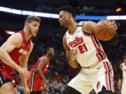 Portland Trail Blazers center Hassan Whiteside (21) drives up against Miami Heat forward Meyers Leonard (0) during the first half of an NBA basketball game, Sunday, Jan. 5, 2020, in Miami.