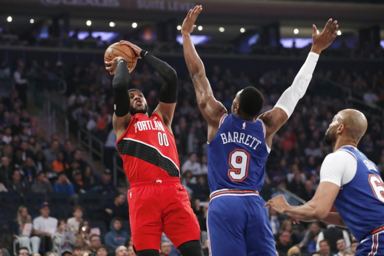 New York Knicks guard RJ Barrett (9) defends as Portland Trail Blazers forward Carmelo Anthony (00) shoots during the first half of an NBA basketball game in New York, Wednesday, Jan. 1, 2020.