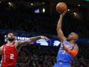Oklahoma City Thunder guard Chris Paul (3) shoots in front of Portland Trail Blazers guard Gary Trent Jr. (2) in the second half of an NBA basketball game Saturday, Jan. 18, 2020, in Oklahoma City.