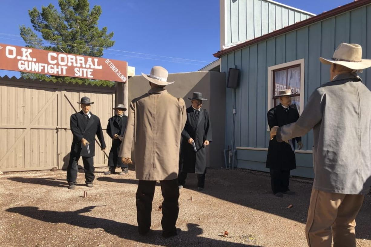 Life-sized replicas of the men who took part in a famous shootout in Tombstone, Ariz., are seen at the OK Corral in Tombstone on Saturday, Nov. 30, 2019. The men, lawmen and cowboys, are positioned as they were during the confrontation that left three dead and became one of the most famous shootouts in the Old West. (AP Photo/Peter Prengaman) (Peter Prengaman/Associated Press)