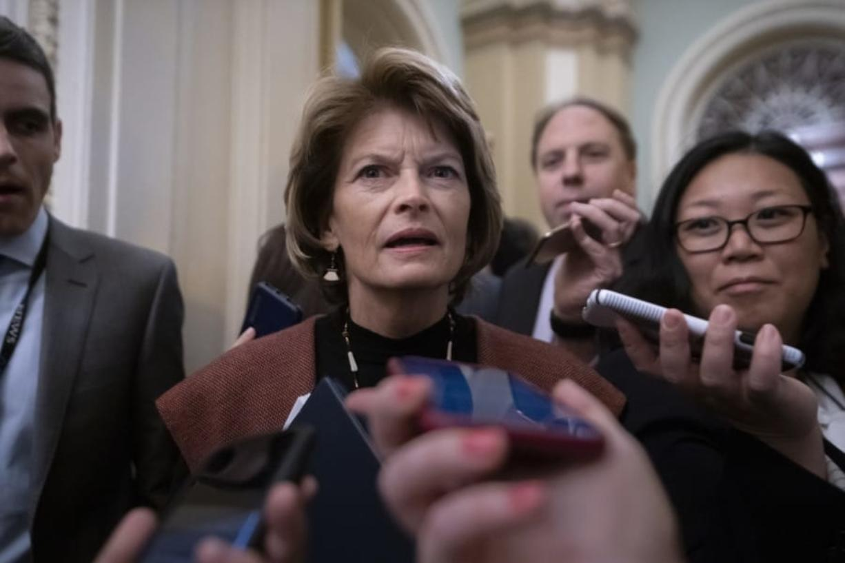 Sen. Lisa Murkowski, R-Alaska, arrives at the Senate for the start of the impeachment trial of President Donald Trump on charges of abuse of power and obstruction of Congress, at the Capitol in Washington, Tuesday, Jan. 21, 2020. (AP Photo/J.