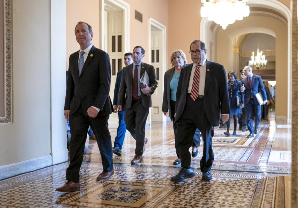 House Democratic impeachment managers, from left, House Intelligence Committee Chairman Adam Schiff, D-Calif., Rep. Jason Crow, D-Colo., Rep. Zoe Lofgren, D-Calif., and House Judiciary Committee Chairman Jerrold Nadler, D-N.Y., arrive for the start of the third day of the impeachment trial of President Donald Trump on charges of abuse of power and obstruction of Congress, at the Capitol in Washington, Thursday, Jan. 23, 2020. (AP Photo/J.