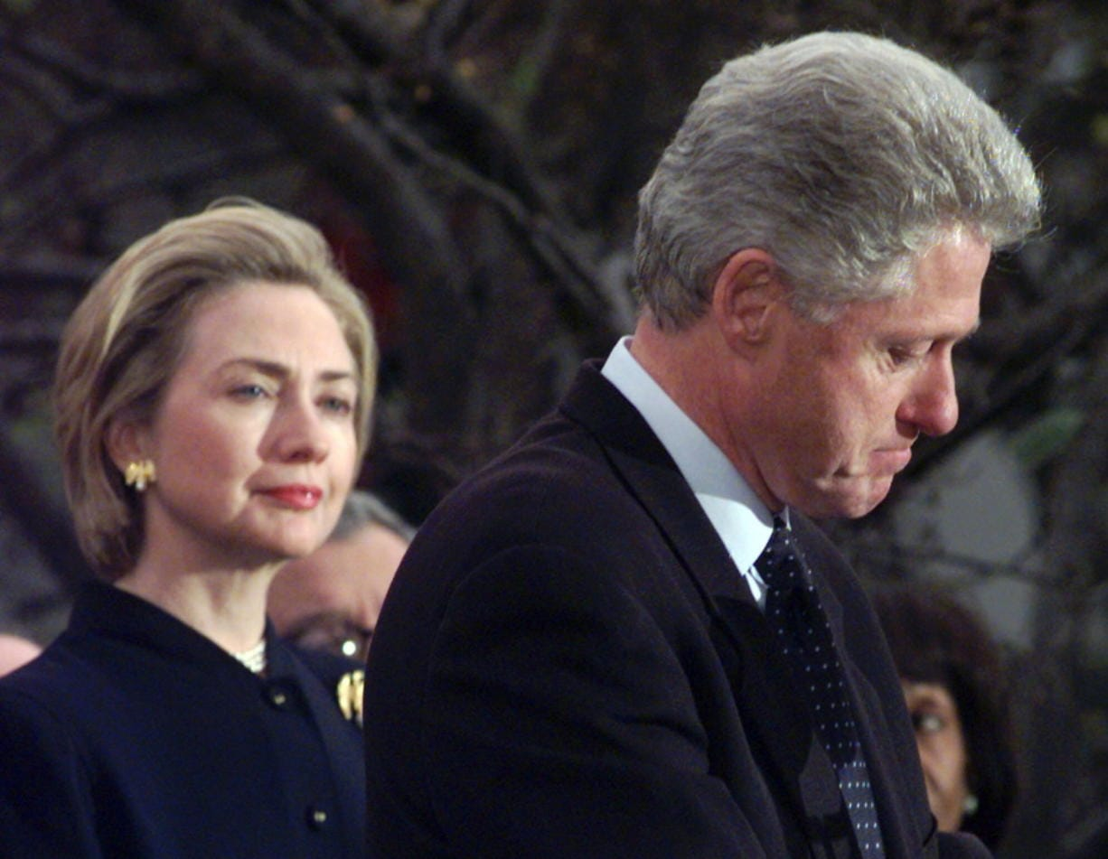 FILE - In this Dec. 19, 1998 file photo, first lady Hillary Rodham Clinton watches President Clinton pause as he thanks those Democratic members of the House of Representatives who voted against impeachment at the White House in Washington. (AP Photo/Susan Walsh, File) (Associated Press files)