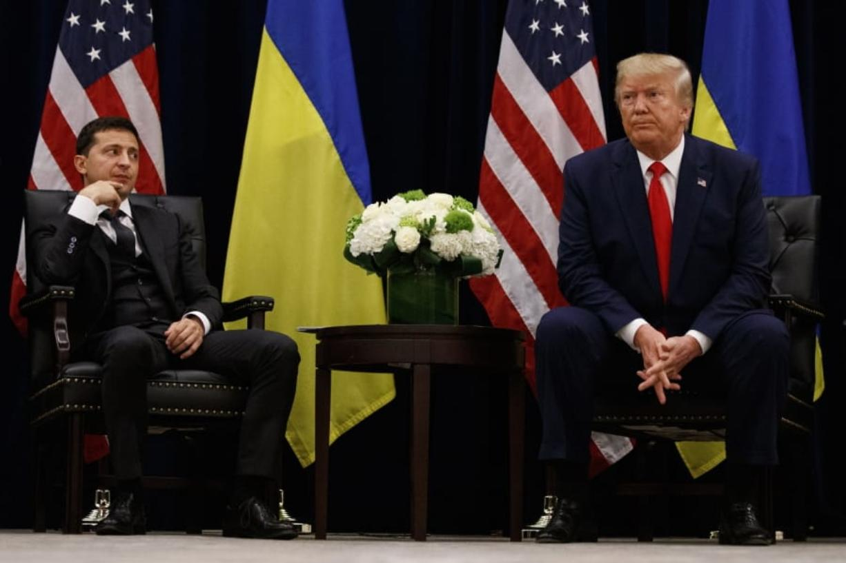"FILE - In this Sept. 25, 2019, file photo, President Donald Trump meets with Ukrainian President Volodymyr Zelenskiy at the InterContinental Barclay New York hotel during the United Nations General Assembly, in New York. It's the story of a president who either had a ""perfect phone call"" with Ukraine or abused his power and should be removed from office. What to watch as presidential impeachment arguments get underway in the Senate for only the third time in American history. (AP Photo/Evan Vucci, File)"