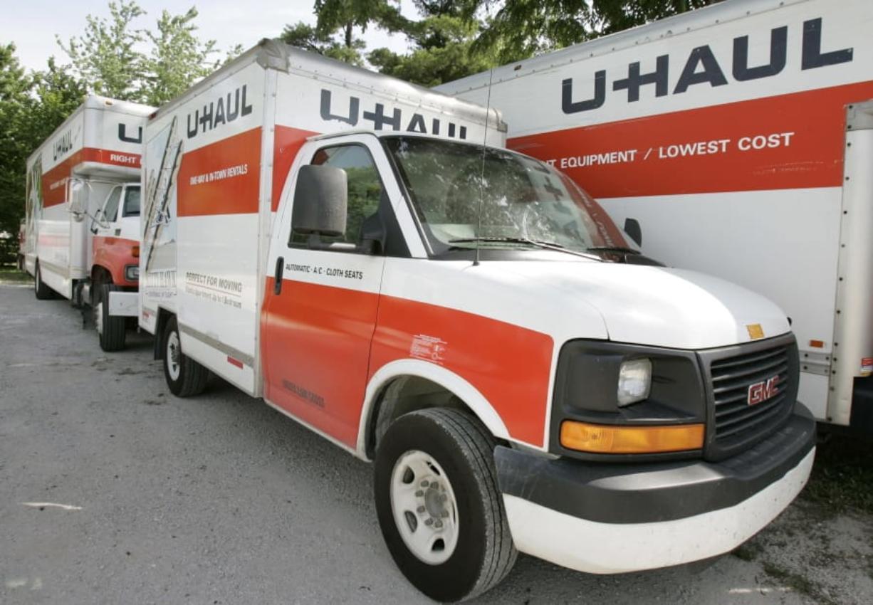 U-Haul trucks sit on a dealer lot in Des Moines, Iowa.