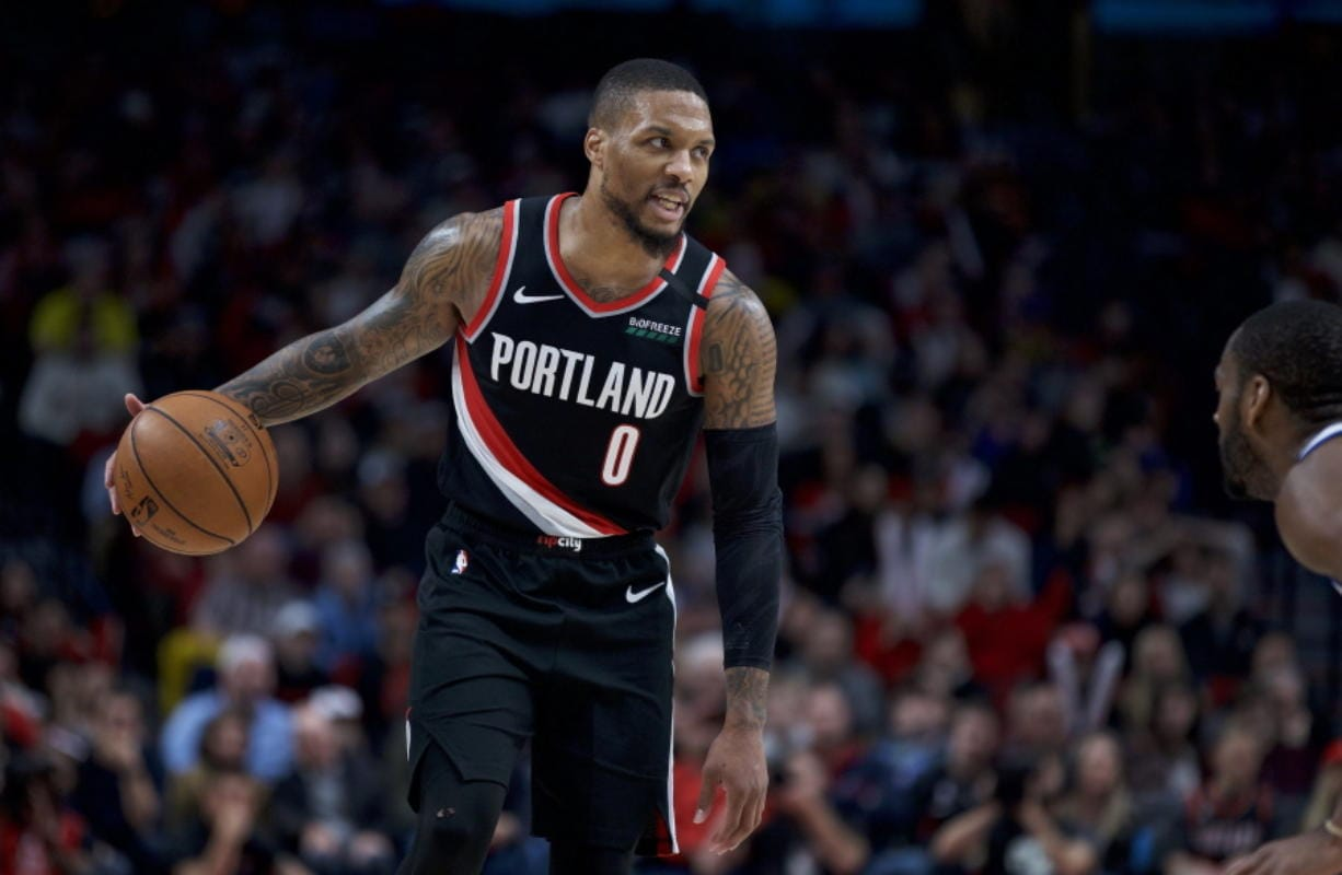 Portland Trail Blazers guard Damian Lillard brings the ball up the court against the Golden State Warriors during the second half of an NBA basketball game in Portland, Ore., Monday, Jan. 20, 2020. The Trail Blazers won 129-124 in overtime.