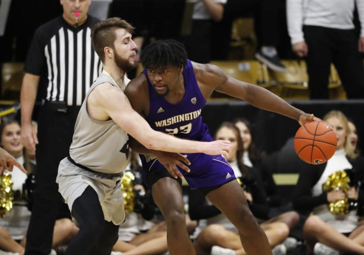 Washington forward Isaiah Stewart, right, drives into Colorado forward Lucas Siewert in the second half of an NCAA college basketball game Saturday, Jan. 25, 2020, in Boulder, Colo.