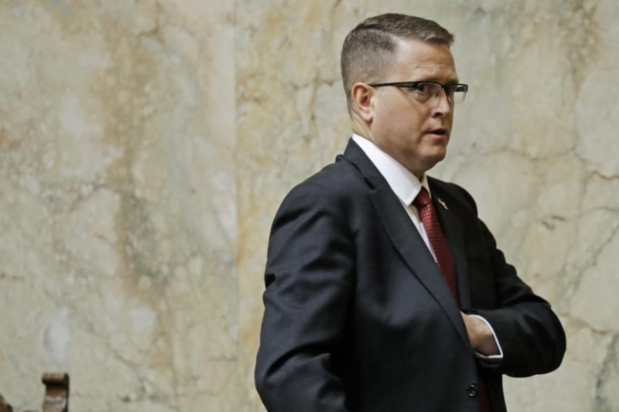 Rep. Matt Shea, R-Spokane Valley, leaves the House floor, Monday, Jan. 13, 2020, following the first day of the 2020 session of the Washington legislature at the Capitol in Olympia, Wash. Shea returned to the Capitol Monday amid calls for his resignation following in the wake of a December report that found he was involved in anti-government activities. (AP Photo/Ted S. Warren)