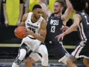 Colorado forward Dallas Walton, left, drives to the rim as Washington State forwards Jeff Pollard, center, and CJ Elleby defend in the first half of an NCAA college basketball game Thursday, Jan. 23, 2020, in Boulder, Colo.