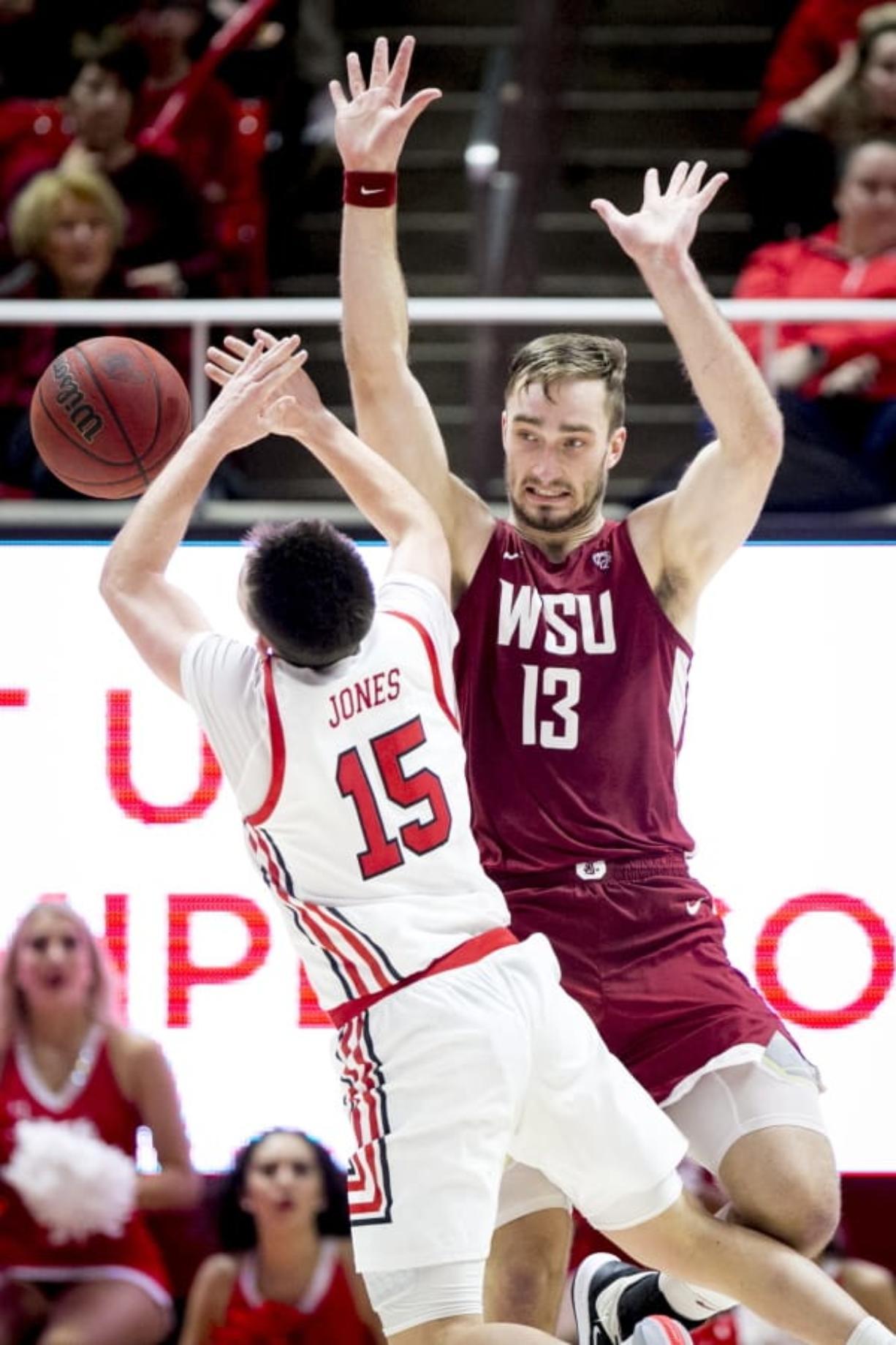 Washington State forward Jeff Pollard (13) fouls Utah guard Rylan Jones (15) who shoots in the second half during an NCAA college basketball game Saturday, Jan. 25, 2020, in Salt Lake City.