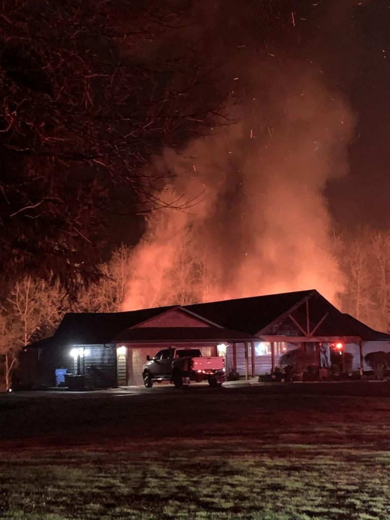 A witness caught this photo of a shop fire behind a home northeast of WSU Vancouver before firefighters arrived Saturday evening.