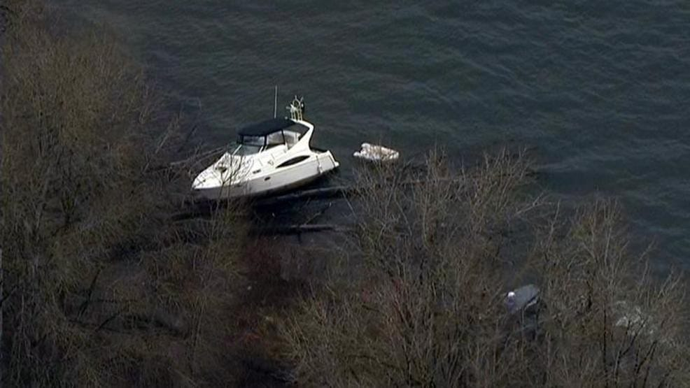 A 36-foot Carver cabin cruiser stolen from a marina in Washougal rests in the Columbia River near Ridgefield where it was run ashore on Tuesday. (KATU)
