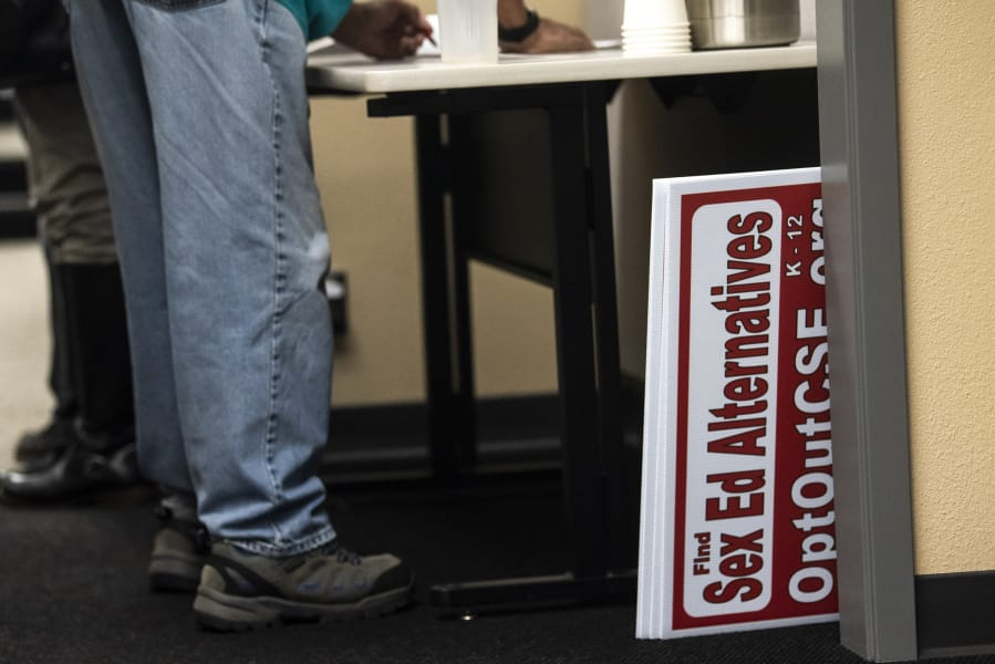 Signs calling for opposition to a proposed sex education curriculum are seen after being confiscated from a community member during a Battle Ground Public Schools Board of Directors meeting in October 2019.
