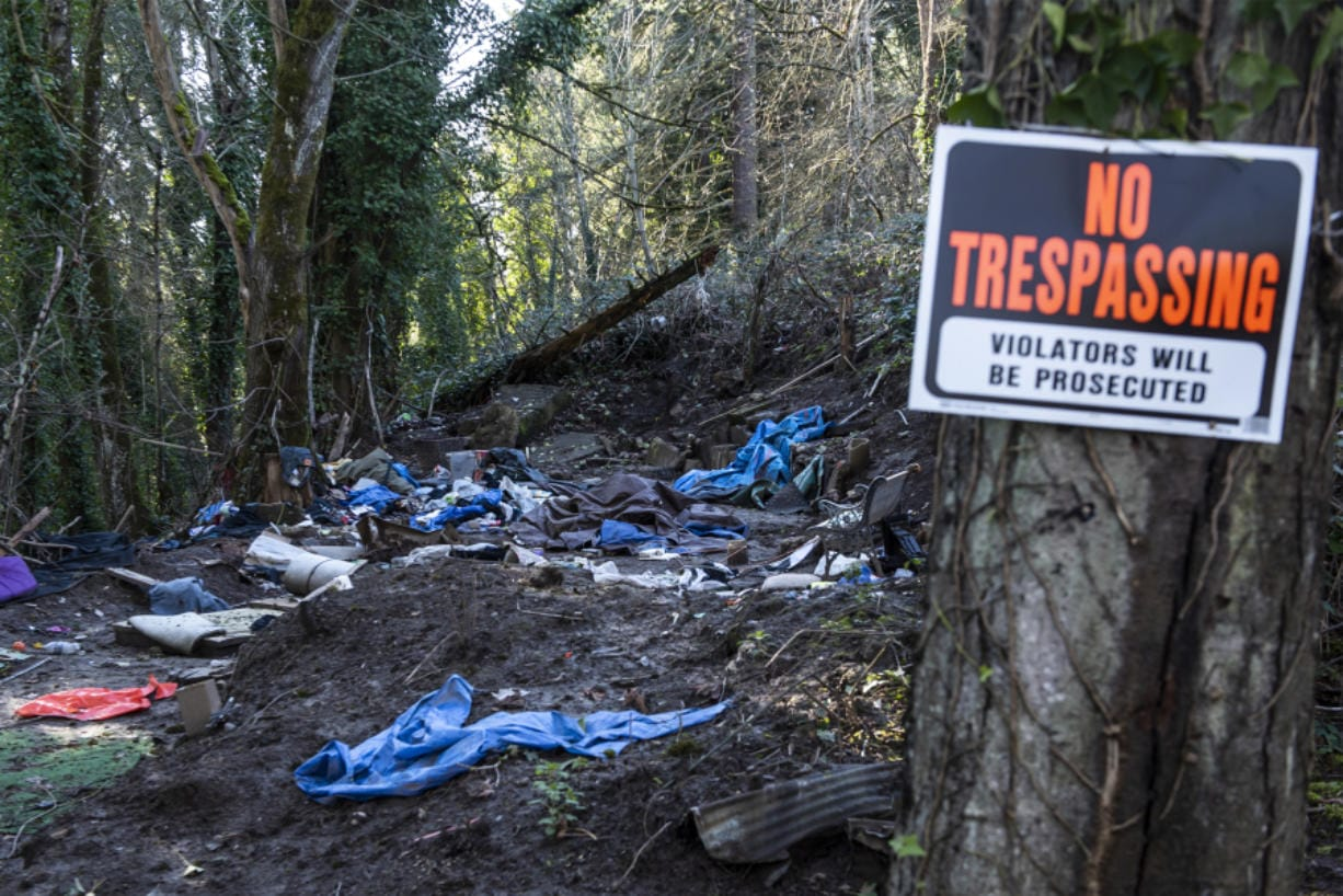 An abandoned campsite is seen Monday afternoon in the woods of north Hazel Dell. Clark County is considering policies to govern how such sites are cleaned up. (Nathan Howard/The Columbian)