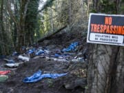 An abandoned campsite is seen Monday afternoon in the woods of north Hazel Dell.