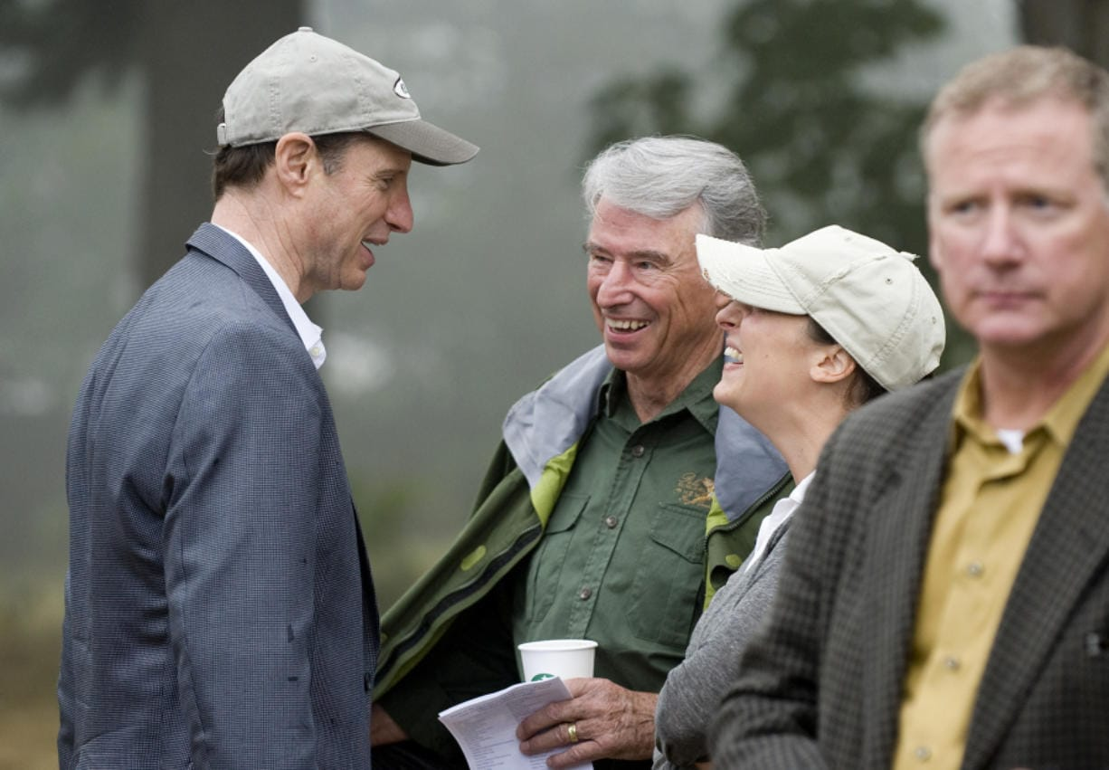 Former Congressman Don Bonker, center, and his daughter, Dawn Elyse Bonker, talk with Sen. Ron Wyden of Oregon in August 2011 at a dedication ceremony for the Nancy Russell Overlook at Cape Horn in the Columbia River Gorge. Bonker cites former U.S. senator and Washington Gov. Dan Evans, a Republican, as someone who showed political leadership and courage with his support of the Columbia River Gorge National Scenic Area Act.