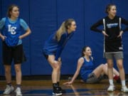 La Center's Natasha Lewis, from left, Kylee Stephens, Gianna DiEmilio, and Mia Edwards rest in between drills during a practice.