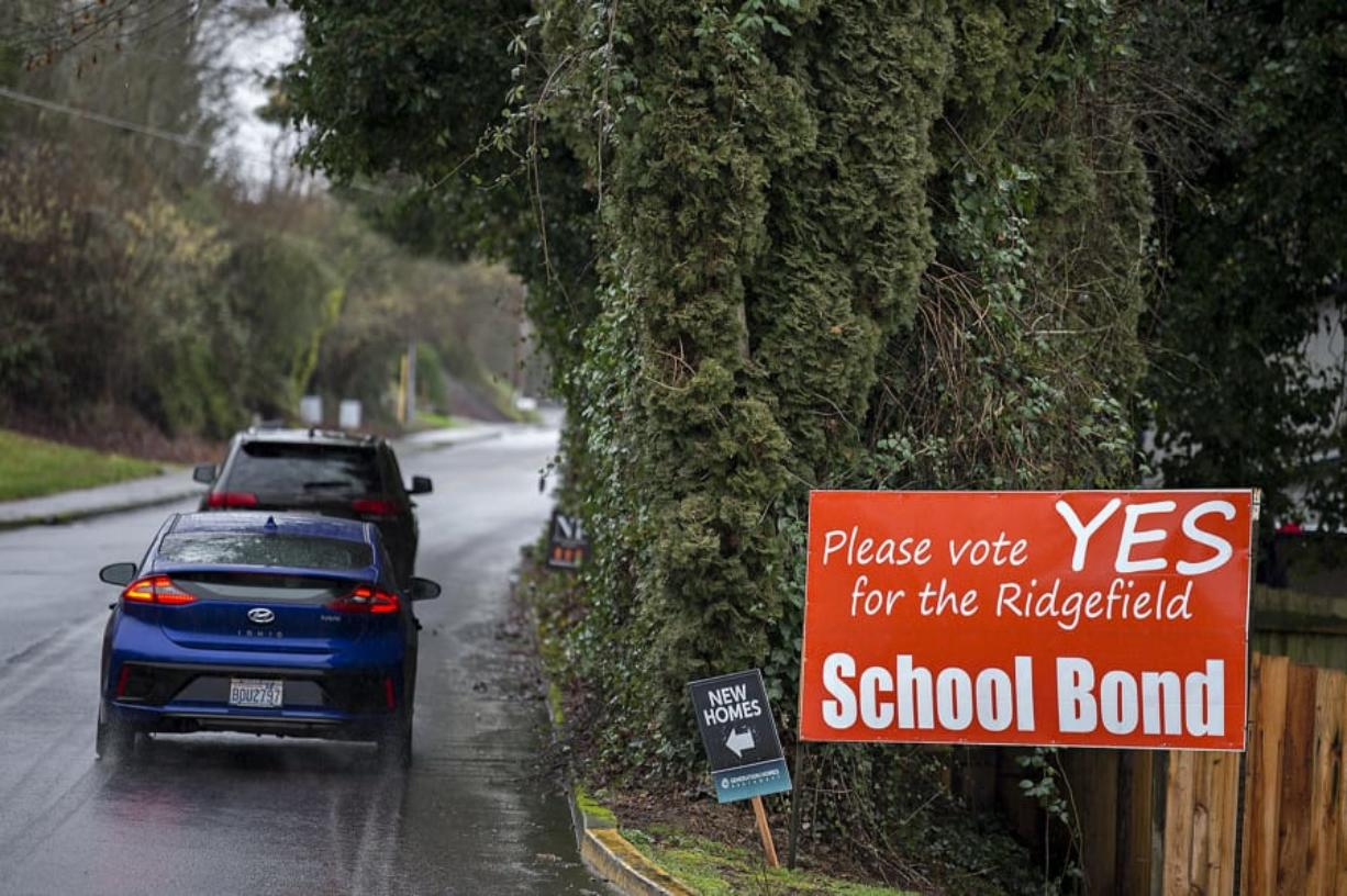 Motorists traveling on South Hillhurst Road pass a sign advertising the upcoming Ridgefield school bond Thursday afternoon, Jan. 23, 2020.