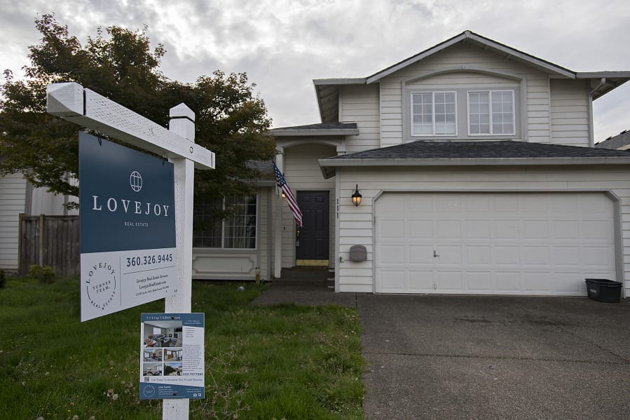 A sign in front of a home for sale in Salmon Creek.