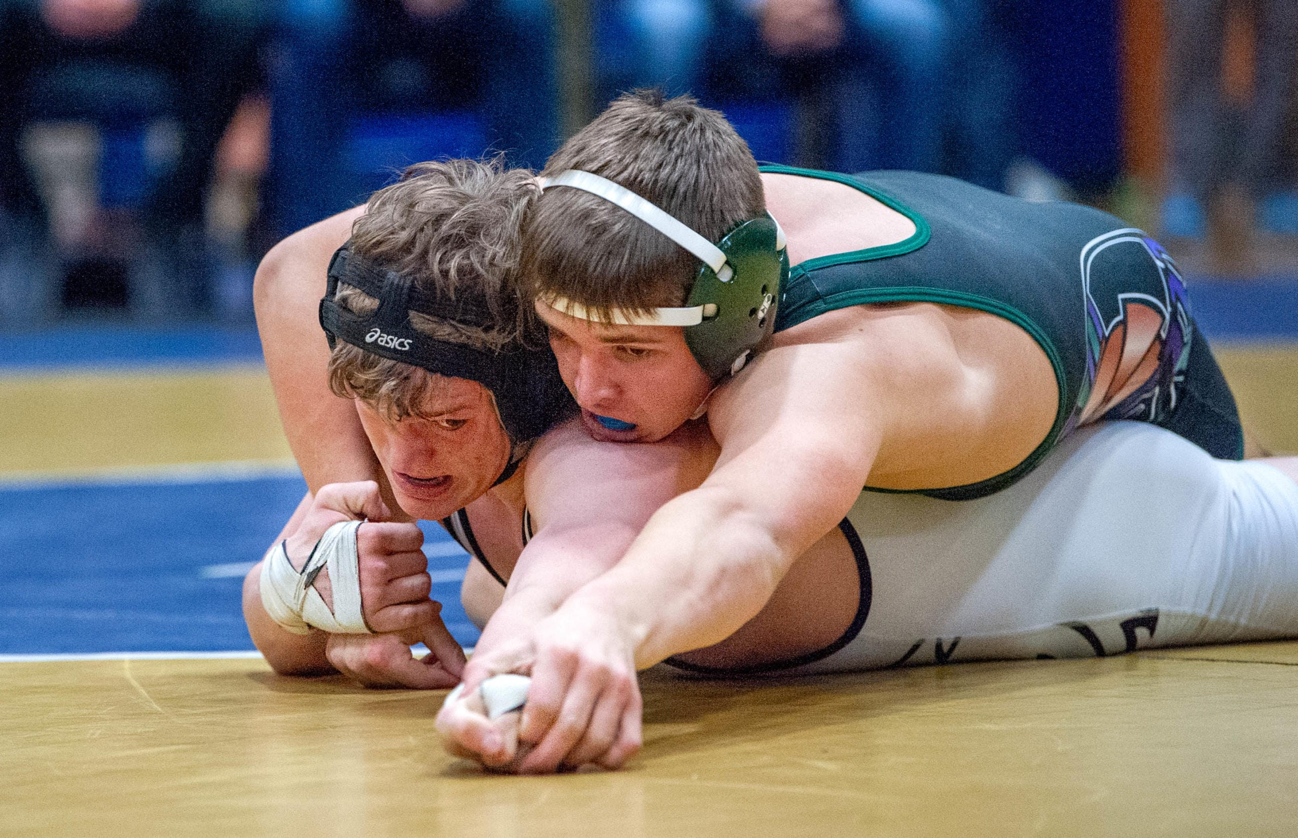 Hudson's Bay's Camden Courtney, bottom, tries to fight for his hand back against Edmonds-Woodway's Alec Rust in their 160-pound championship match at the WIAA Region 2 Tournament on Saturday at Kelso.