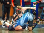 Union's Nevaeh Cassidy, top, takes down Curtis' Katrina Wangen in their 155-pound championship match at the WIAA Girls Region 3 Tournament.