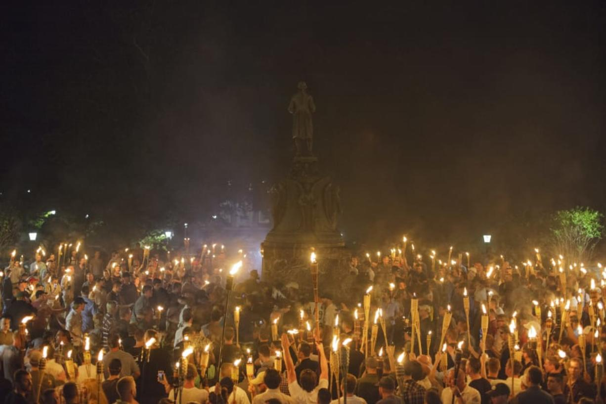 Neo Nazis, Alt-Right, and White Supremacists encircle counter protestors at the base of a statue of Thomas Jefferson after marching through the University of Virginia campus with torches in Charlottesville, Va., USA on August 11, 2017 (Shay Horse/NurPhoto via Getty Images/TNS)