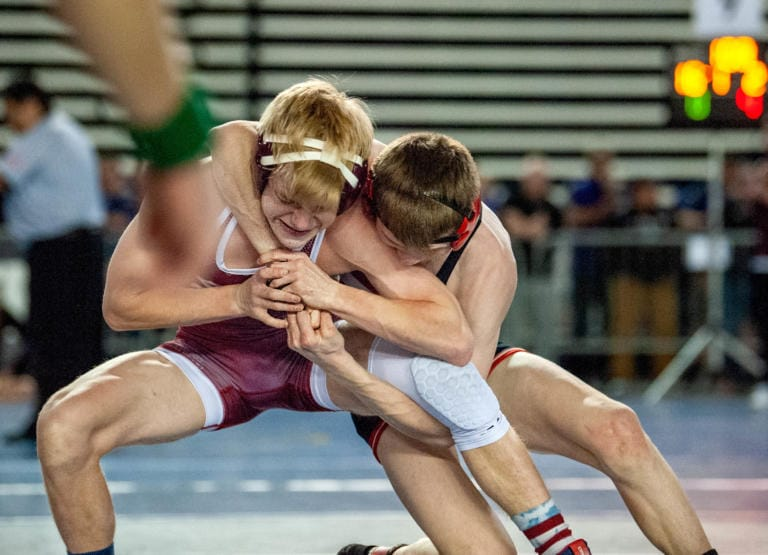 Camas sophomore Porter Craig, right, fights the hands of South Kitsap's Payton Motter in the Class 4A 106-pound quarterfinal on Friday at Mat Classic XXXII in the Tacoma Dome. Craig won by 5-0 decision. (Joshua Hart/The Columbian)