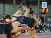Camas' Gideon Malychewski competes in a 160-pound quarterfinal match at Mat Classic XXXII on Friday.