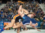 Washougal's Aleksi Donahue takes down Mount Rainier's Trisity Marshall in a 120-pound first-round match at Mat Classic XXXII Friday at the Tacoma Dome. Donahue secured the pin quickly afterward.