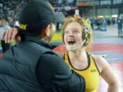 Hudson's Bay's Allison Blaine celebrates her third state title, a 15-4 decision victory in the 135-pound girls finals.