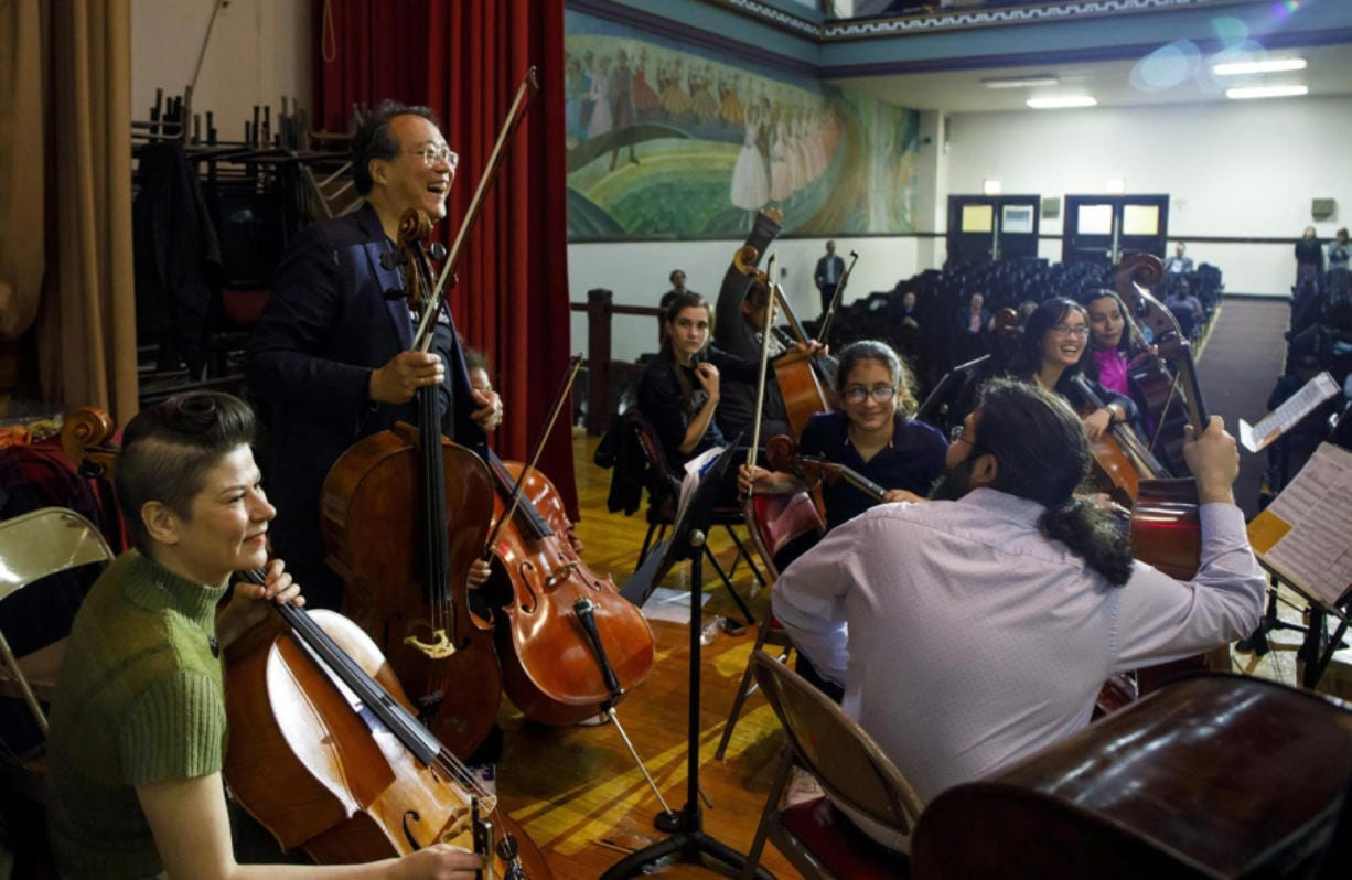 Yo-Yo Ma greets students and Civic Orchestra of Chicago members as they play together Nov. 30, 2017, at Chopin Elementary.