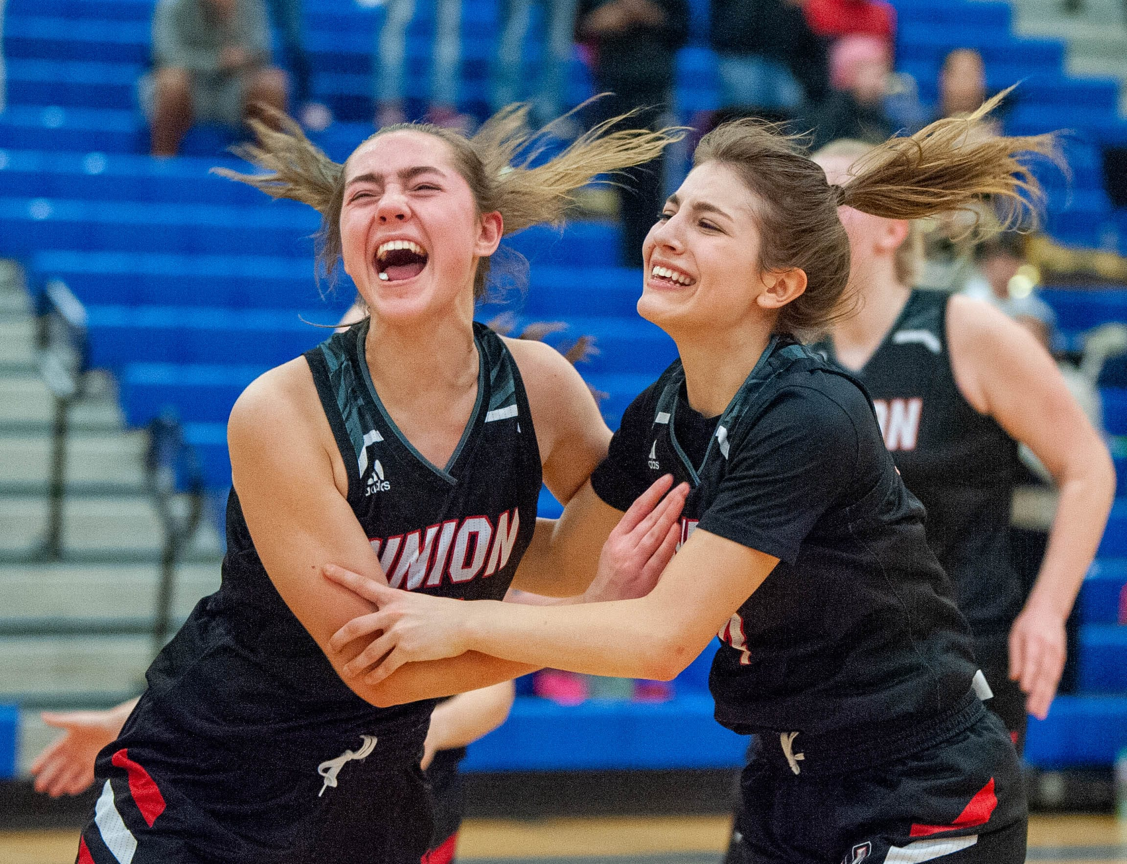 Union's Lolo Weatherspoon, left, and Mason Oberg celebrate their 48-47 win over Todd Beamer in a 4A State Regional on Friday at Auburn Mountainview High School. (Joshua Hart/The Columbian)