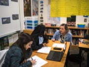 Woodland High School seniors Rachel Young, left, and Ariana Vega, center, talk with their teacher Shari Conditt during their advanced government class at Woodland High School. Experts say allowing students to discuss controversial subjects in the classroom can build more critical readers, thinkers and voters.