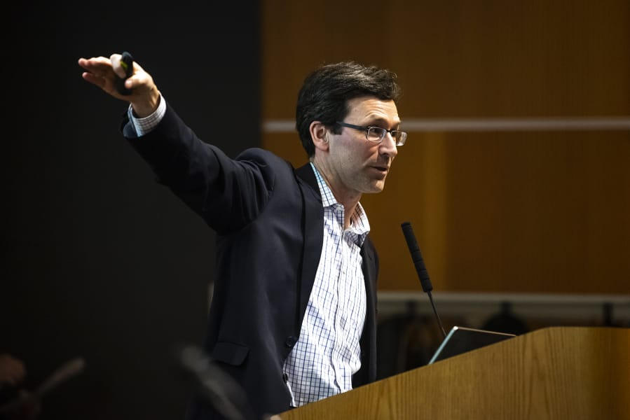 """Washington State Attorney General Bob Ferguson speaks about the state's lawsuit against Motel 6 for their practice of sharing guest's names with U.S. Immigration and Customs Enforcement during The Columbian's """"Bridging the Border"""" forum at the Vancouver Community Library on Thursday."""