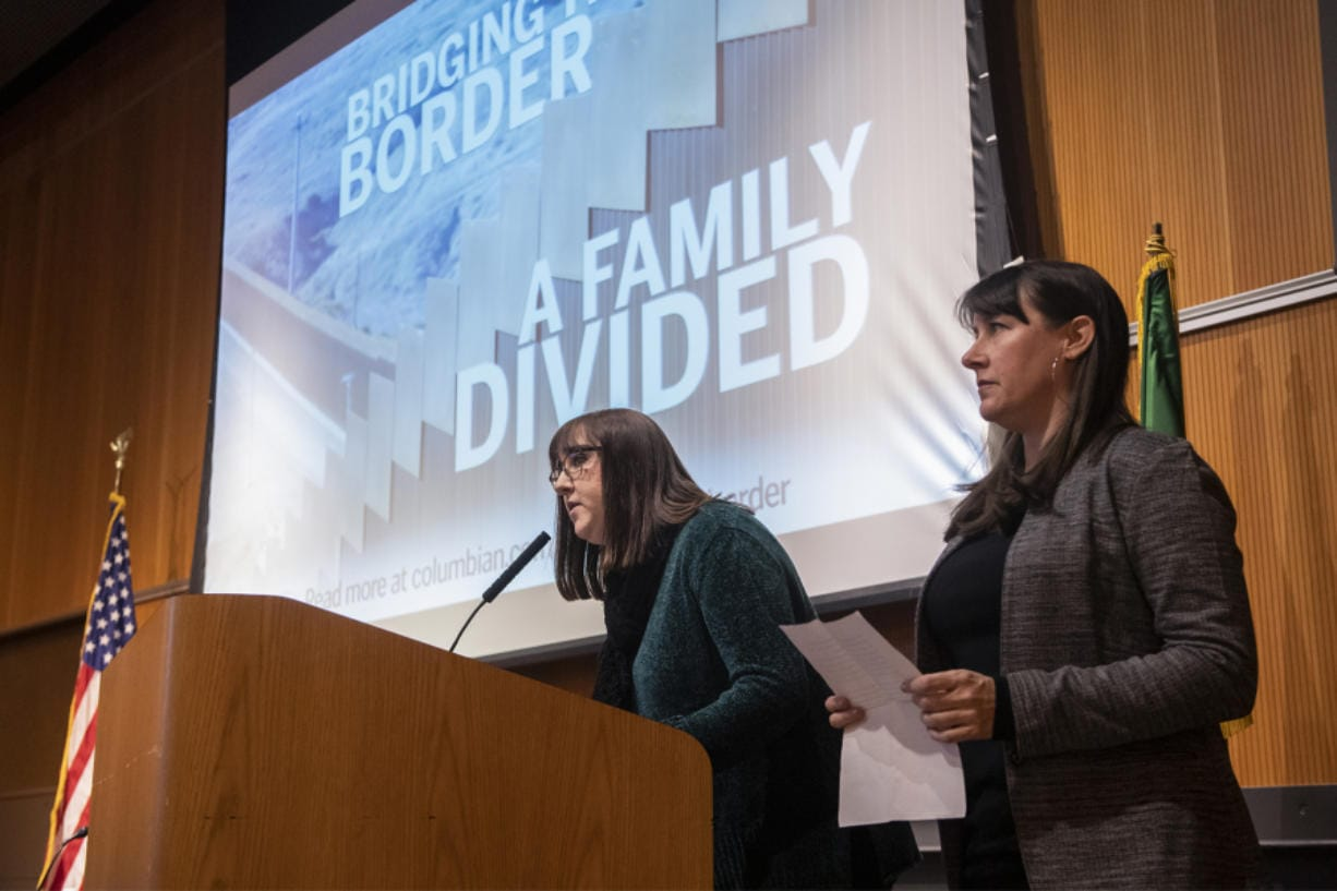 "Nathan Howard/The Columbian Assistant Metro Editor Jessica Prokop, left, and Photo Editor Amanda Cowan speak about their reporting of ""Bridging the Border."""