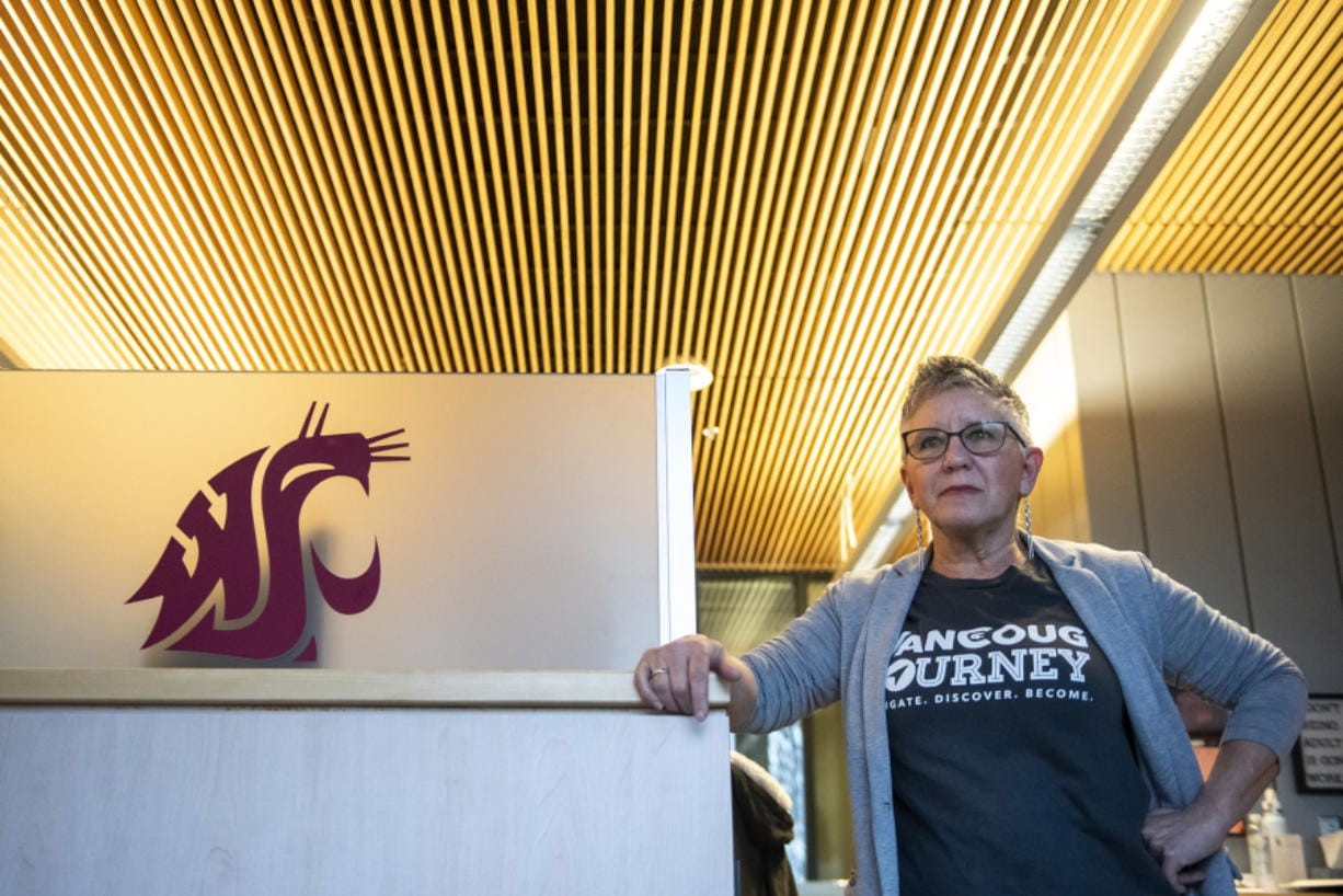 """Kim McDougall, financial aid outreach counselor at Washington State University Vancouver, helps to """"demystify"""" the financial side of college for prospective students at local high schools. (Nathan Howard/The Columbian)"""