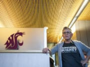 """Kim McDougall, financial aid outreach counselor at Washington State University Vancouver, helps to """"demystify"""" the financial side of college for prospective students at local high schools."""