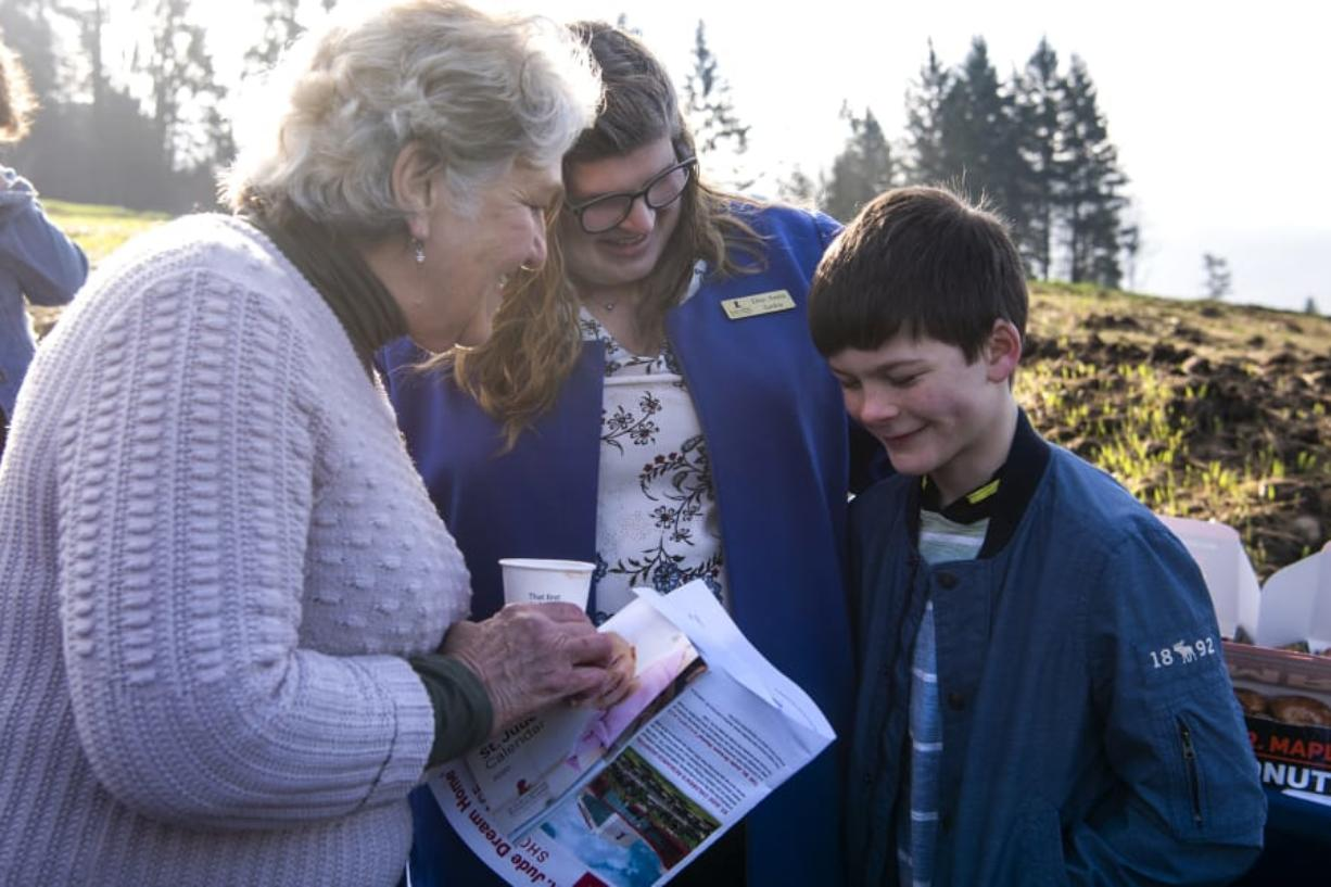 Washougal Mayor Molly Coston, left, talks with DeeAnna Janku, development representative for St. Jude Children's Research Hospital, and Janku's son Gideon during the groundbreaking for a St. Jude Dream Home in Washougal. Gideon was diagnosed with a rare form of melanoma and does checkups with St. Jude in Tennessee. The house will be built without cost to St. Jude, but all proceeds from the sale will benefit the hospital. Gideon turns 10 on Saturday. (Alisha Jucevic/The Columbian)