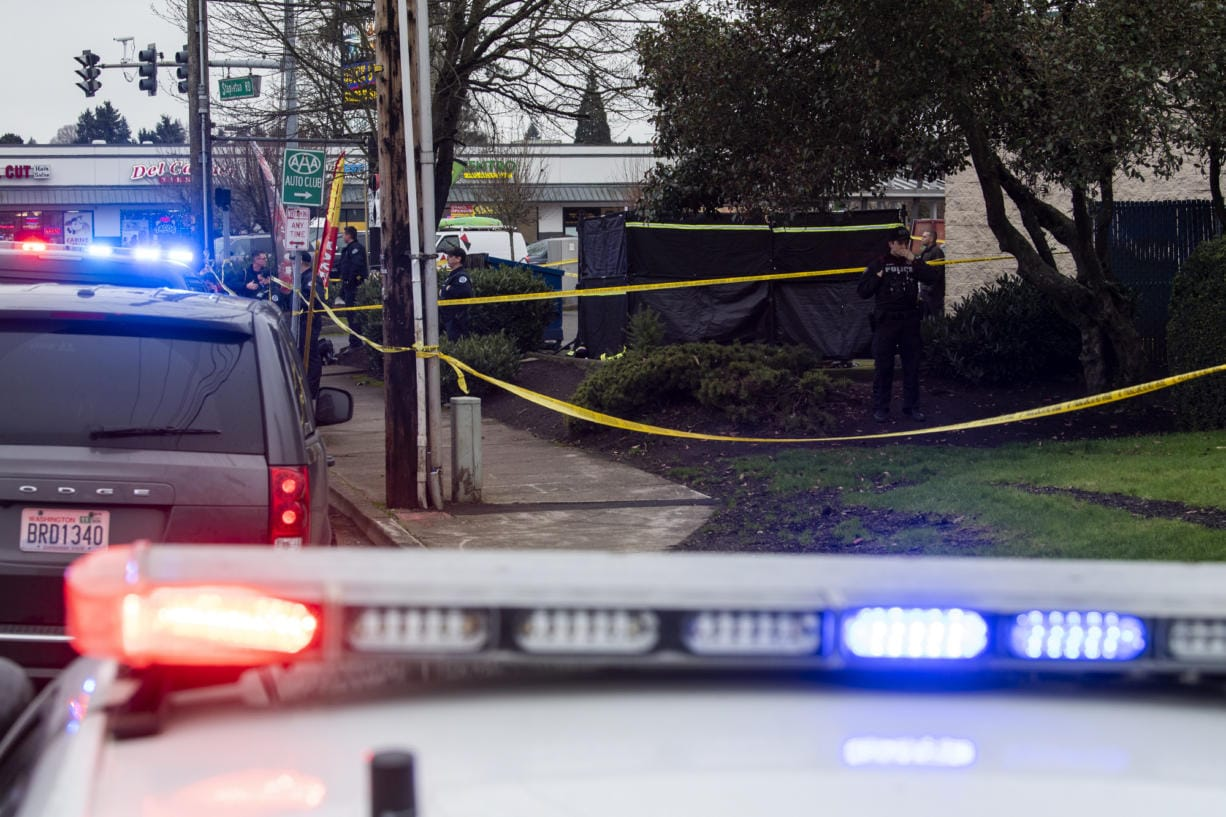 Vancouver police investigate a fatal shooting at Stapleton Road and Fourth Plain Boulevard in central Vancouver on Feb. 4, 2020. A young man was shot and killed. The victim's identity has not been released.