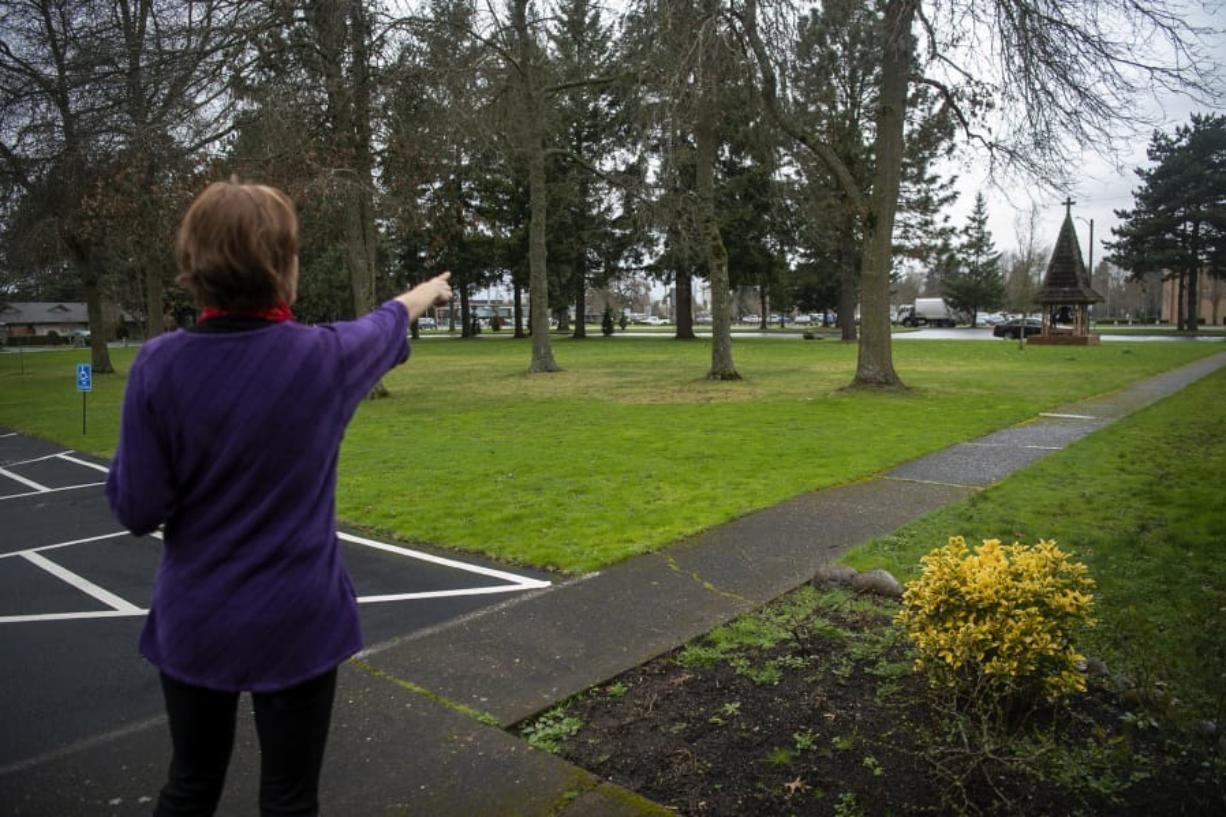 The Rev. JoAnn Schaadt-Shipley of Vancouver Heights United Methodist Church points to the area on the grounds where the church is hoping to build a walking labyrinth.